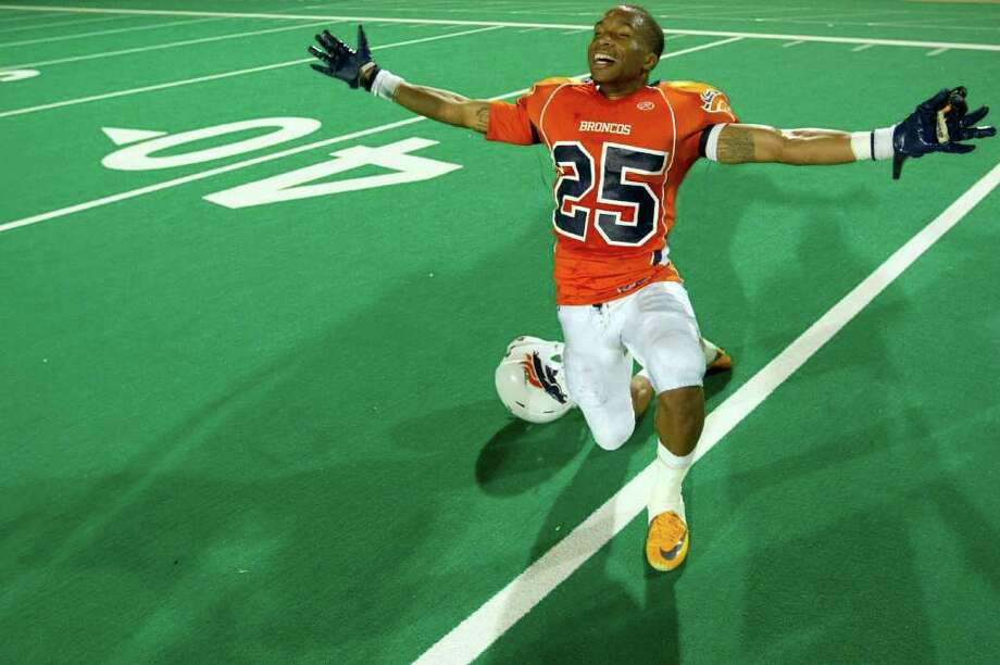 Malcom Smiley (25) celebrates at midfield after the Bush Broncos defeated Travis to clinch their first playoff berth with a 38-23 victory in a high school football game at  Mercer Stadium, Saturday, Oct. 29, 2011, in Sugar Land. Photo: Smiley N. Pool, Houston Chronicle / © 2011  Houston Chronicle