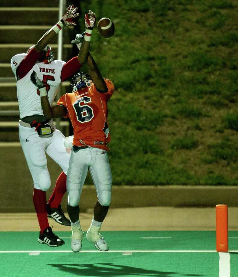 Bush defensive back Chad Davis (6) knocks a pass away from Travis wide receiver Dequarious Davis (5) during the fourth quarter of a high school football game at  Mercer Stadium, Saturday, Oct. 29, 2011, in Sugar Land. Photo: Smiley N. Pool, Houston Chronicle / © 2011  Houston Chronicle