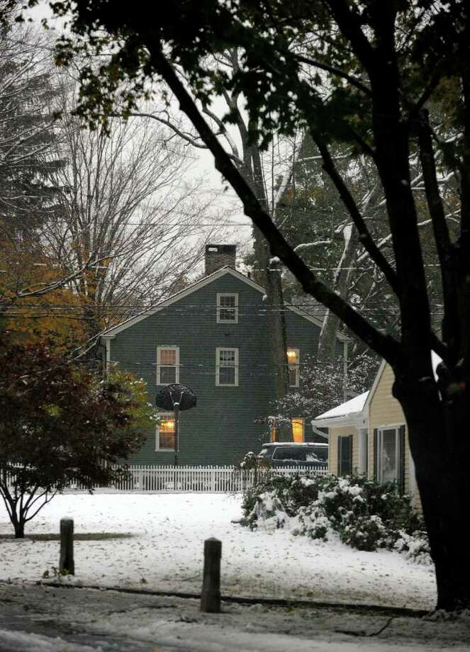 A view of a home along Old Mill Road during a snow storm in Fairfield, Conn. on Saturday October 29, 2011. Photo: Christian Abraham / Connecticut Post
