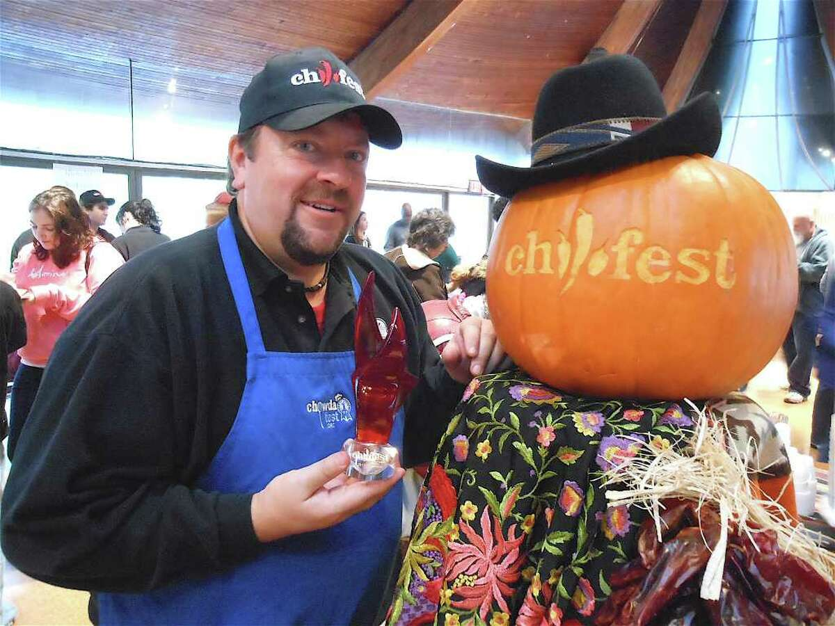 Jim Keenan, the chief organizer of Chilifest in Westport, holds the trophy to be awarded to the best chili concoction during the Saturday event at the Unitarian Church.
