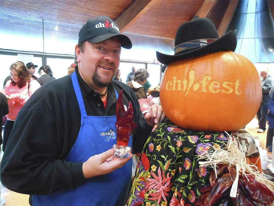 Jim Keenan, the chief organizer of Chilifest in Westport, holds the trophy to be awarded to the best chili concoction during the Saturday event at the Unitarian Church. Photo: Mike Lauterborn / Westport News contributed