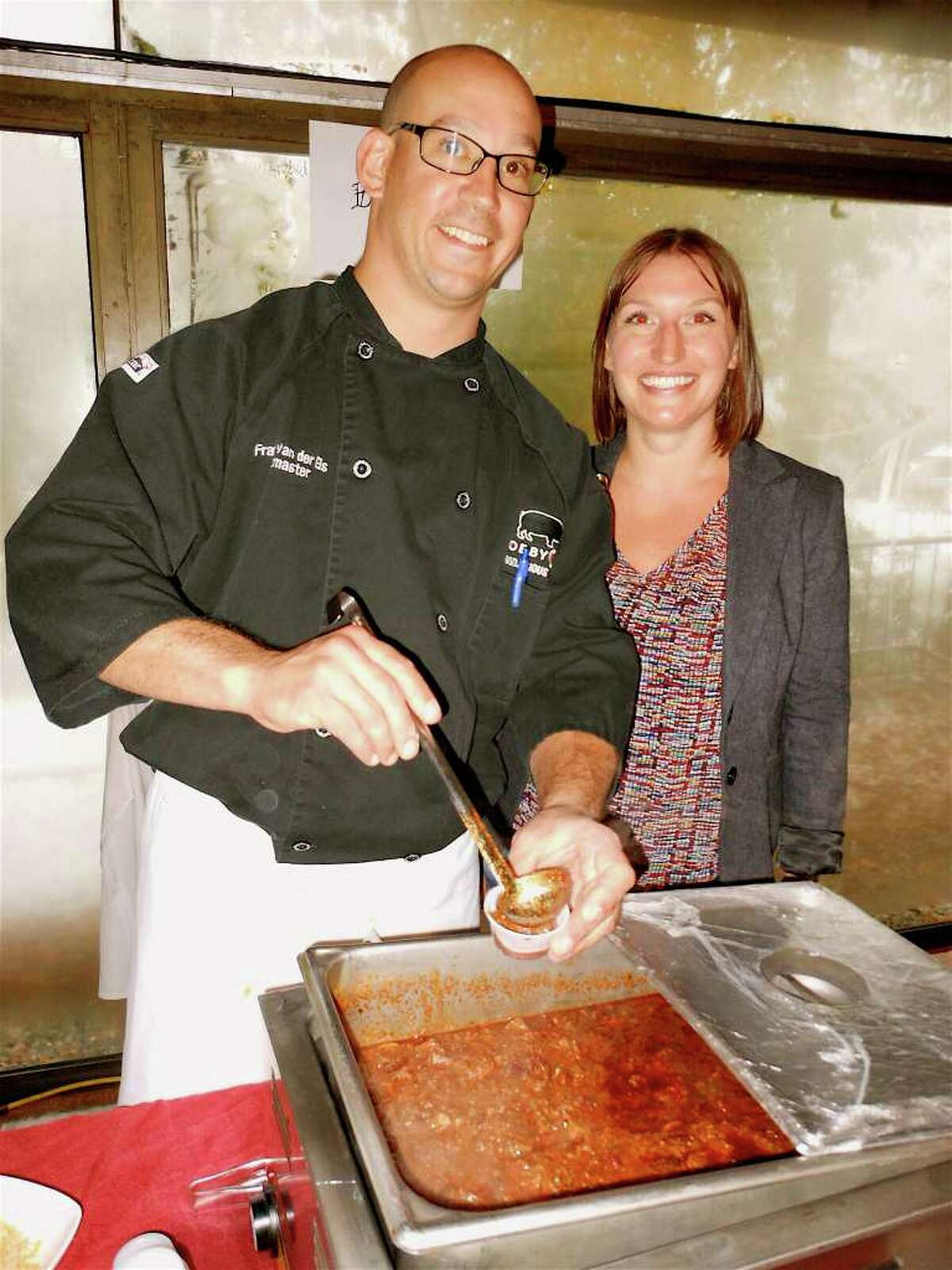 Bobby Q's Restaurant Pitmaster Frans van der Els, serving Smokehouse Chili with Sarah Colwell at the Chilifest on Saturday in Westport.