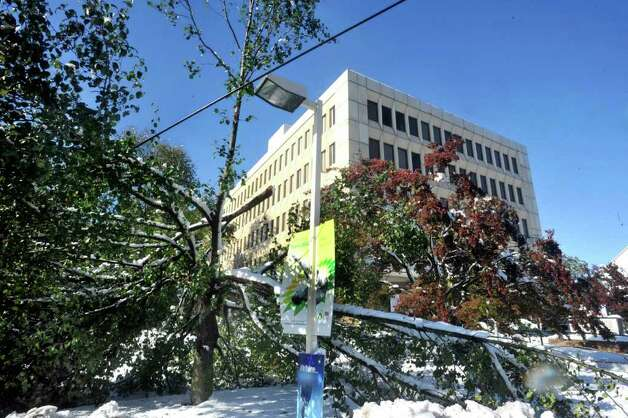 Fallen tree limbs took down electrical power lines in front of the Hess Gas station on Main Street in Danbury Sunday, Oct. 30, 2011. Photo: Michael Duffy