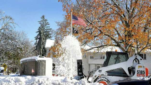 Snow removal is happening early this year in front of the War Memorial in Danbury Sunday, Oct. 30, 2011. Photo: Michael Duffy