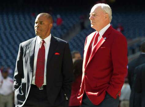 Houston Texans general manager Rick Smith, left, and team owner Bob McNair watch warm-ups before an NFL football game against the Jacksonville Jaguars at Reliant Stadium on Sunday, Oct. 30, 2011, in Houston. Photo: Brett Coomer, Houston Chronicle / © 2011  Houston Chronicle