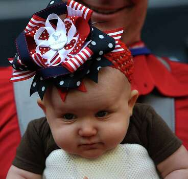 Seven-month-old Stacy Anderson on the sidelines before the start of an NFL football game at Reliant Stadium, Oct. 30, 2011. Photo: Karen Warren, Houston Chronicle / © 2011 Houston Chronicle