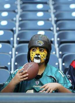 Jaguar fan Desire Cano, 8,  before the start of an NFL football game at Reliant Stadium, Oct. 30, 2011. Photo: Karen Warren, Houston Chronicle / © 2011 Houston Chronicle