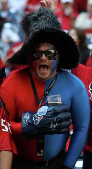 Texans fan Michael Poulos II, of Houston in the first quarter of an NFL football game at Reliant Stadium, Oct. 30, 2011. Photo: Karen Warren, Houston Chronicle / © 2011 Houston Chronicle