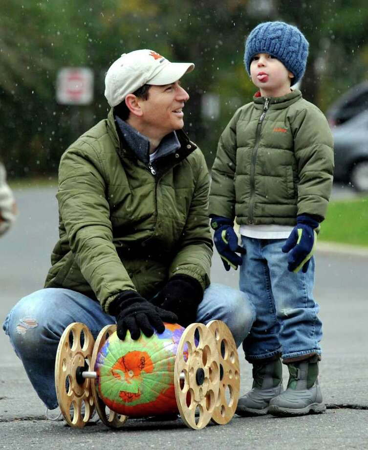 John Masotta gives some last minute race tips his son, Noah, 5, who doesn't seem impressed,- or is he tasting the falling snow? - just before the start of the Great Pumpkin Race in Newtown. Photo: Michael Duffy