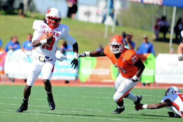 Lamar Cardinals quarterback Jeremy Johnson tries to evade Sam Houston State linebacker Will Henry in the first half at Bowers Stadium, in Huntsville on Saturday, October 29, 2011.  Valentino Mauricio/The Enterprise Photo: Valentino Mauricio