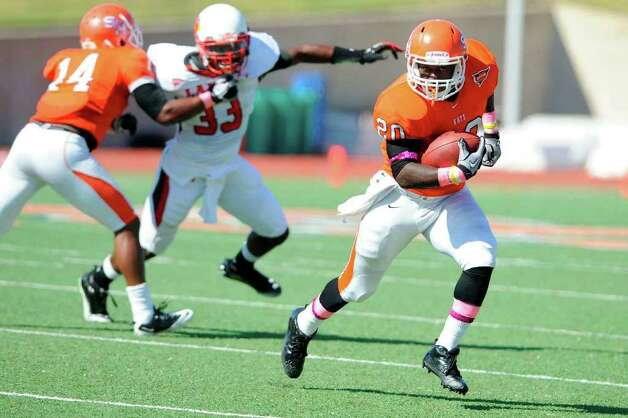 Sam Houston State University running back Tim Flanders (20) rushes against the Lamar Cardinals in the first half of their Southland Conference game at Bowers Stadium in Huntsville,Texas. Saturday, October 29, 2011. The Bearkats toppled the Cardinals 66-0.  Valentino Mauricio/The Enterprse Photo: Valentino Mauricio