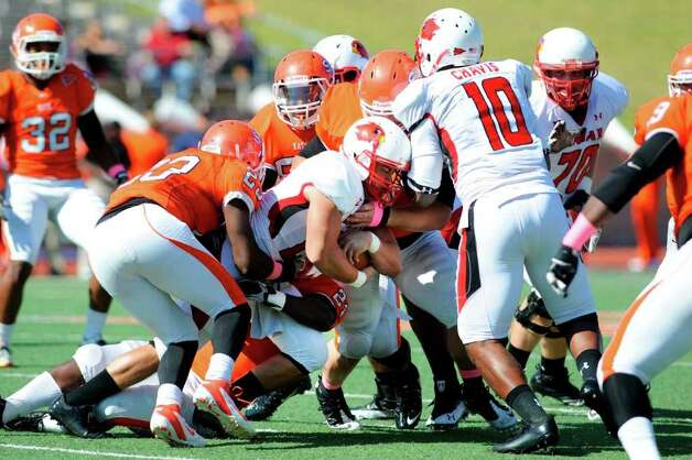 Lamar Cardinals running back Caleb Harmon is brought down by the Sam Houston State defense in the first half of their game at Bowers Stadium, Huntsville, Texas. Saturday, October 29, 2011.  Valentino Mauricio/The Enterprise Photo: Valentino Mauricio