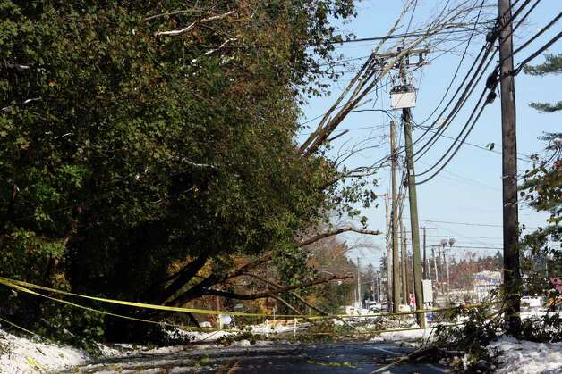 Fallen trees and downed wires block Main Street in Monroe on Sunday, October 30, 2011. Saturday's nor'easter left Monroe residents without power. Photo: B.K. Angeletti / Connecticut Post