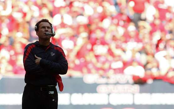 Houston Texans head coach Gary Kubiak watches a replay on the big screen in the second quarter of an NFL football game at Reliant Stadium, Oct. 30, 2011. Photo: Karen Warren, Houston Chronicle / © 2011 Houston Chronicle