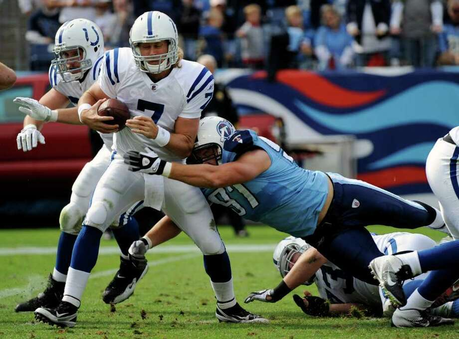 Indianapolis Colts quarterback Curtis Painter (7) is sacked by Tennessee Titans defensive tackle Karl Klug (97) for an 8-yard loss in the second quarter of an NFL football game Sunday, Oct. 30, 2011, in Nashville, Tenn. (AP Photo/Frederick Breedon) Photo: Frederick Breedon, Associated Press / FR159542 AP