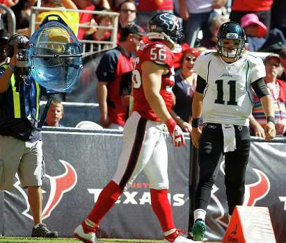 Jacksonville Jaguars quarterback Blaine Gabbert (11) jaws with Houston Texans inside linebacker Brian Cushing (56) which was caught by the parabolic microphone (on the left) in the third quarter of an NFL football game at Reliant Stadium, Oct. 30, 2011. Photo: Karen Warren, Houston Chronicle / © 2011 Houston Chronicle