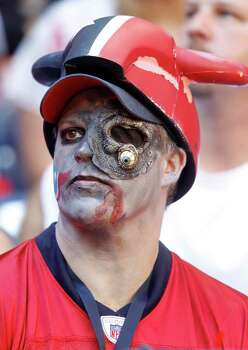 Donnie Eason, of League City, wears his Halloween costume as he watches the game in the fourth quarter of an NFL football game at Reliant Stadium, Oct. 30, 2011.  Houston won the game 24-14. Photo: Karen Warren, Houston Chronicle / © 2011 Houston Chronicle