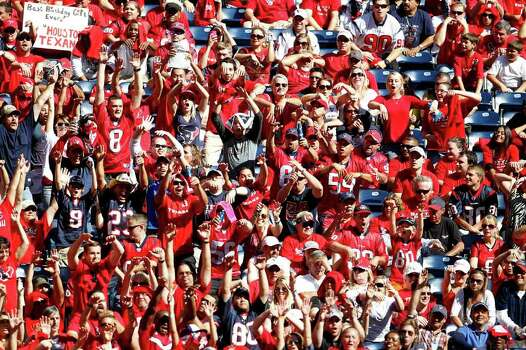 Fans do the wave in the stadium in the fourth quarter of an NFL football game at Reliant Stadium, Oct. 30, 2011.  Houston won the game 24-14. Photo: Karen Warren, Houston Chronicle / © 2011 Houston Chronicle