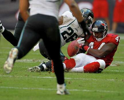 Houston Texans running back Ben Tate (44) tries to hang onto the ball as he battles against Jacksonville Jaguars free safety Dawan Landry (26) as he fumbles the ball which resulted in a turnover in the fourth quarter of an NFL football game at Reliant Stadium, Oct. 30, 2011.  Houston won the game 24-14. Photo: Karen Warren, Houston Chronicle / © 2011 Houston Chronicle