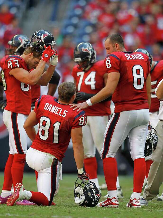 Houston Texans quarterback Matt Schaub (8) chats with  tight end Owen Daniels (81) in the huddle in the fourth quarter of an NFL football game at Reliant Stadium, Oct. 30, 2011.  Houston won the game 24-14. Photo: Karen Warren, Houston Chronicle / © 2011 Houston Chronicle