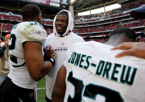 Houston Texans wide receiver Andre Johnson (80) chats with Jacksonville Jaguars outside linebacker Daryl Smith (52) after the Texans won the game 24-14 against Jacksonville during an NFL football game at Reliant Stadium, Oct. 30, 2011. Photo: Karen Warren, Houston Chronicle / © 2011 Houston Chronicle