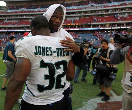 Houston Texans wide receiver Andre Johnson (80) chats with Jacksonville Jaguars running back Maurice Jones-Drew (32) after the Texans won the game 24-14 against Jacksonville during an NFL football game at Reliant Stadium, Oct. 30, 2011. Photo: Karen Warren, Houston Chronicle / © 2011 Houston Chronicle