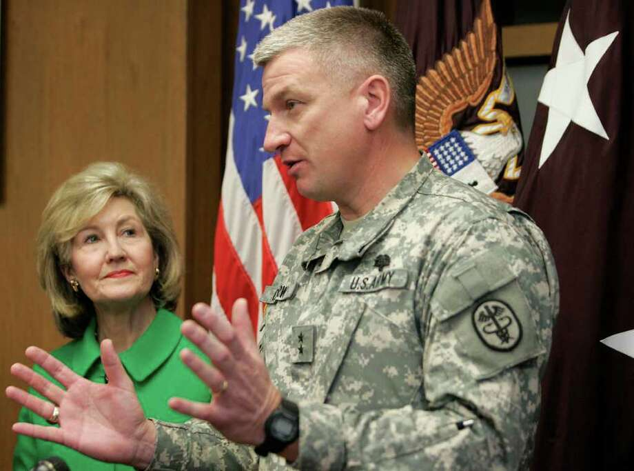 Sen. Kay Bailey Hutchison, with Army Maj. Gen. Russell Czerw in 2009, is pressing a deficit reduction panel to cut spending for overseas military bases as part of a $1.5 trillion plan. She aims to make the cuts beneficial for Texas. Photo: Express-News File Photo / Alicia Wagner Calzada
