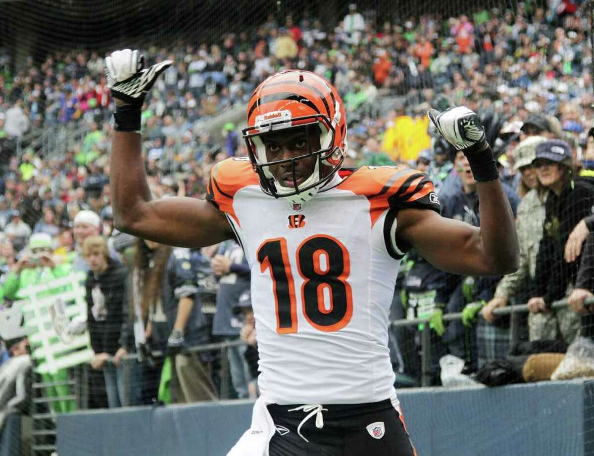 SEATTLE - OCTOBER 30: Wide receiver A.J. Green #18 of the Cincinnati Bengals celebrates after scoring a touchdown against the Seattle Seahawks at CenturyLink Field on October 30, 2011 in Seattle, Washington.