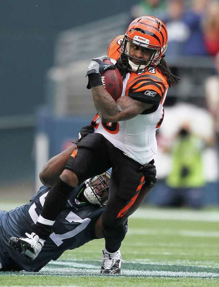 SEATTLE - OCTOBER 30:  Running back Bernard Scott #28 of the Cincinnati Bengals rushes against David Hawthorne #57 of the Seattle Seahawks at CenturyLink Field on October 30, 2011 in Seattle, Washington. Photo: Otto Greule Jr, Getty Images / 2011 Getty Images