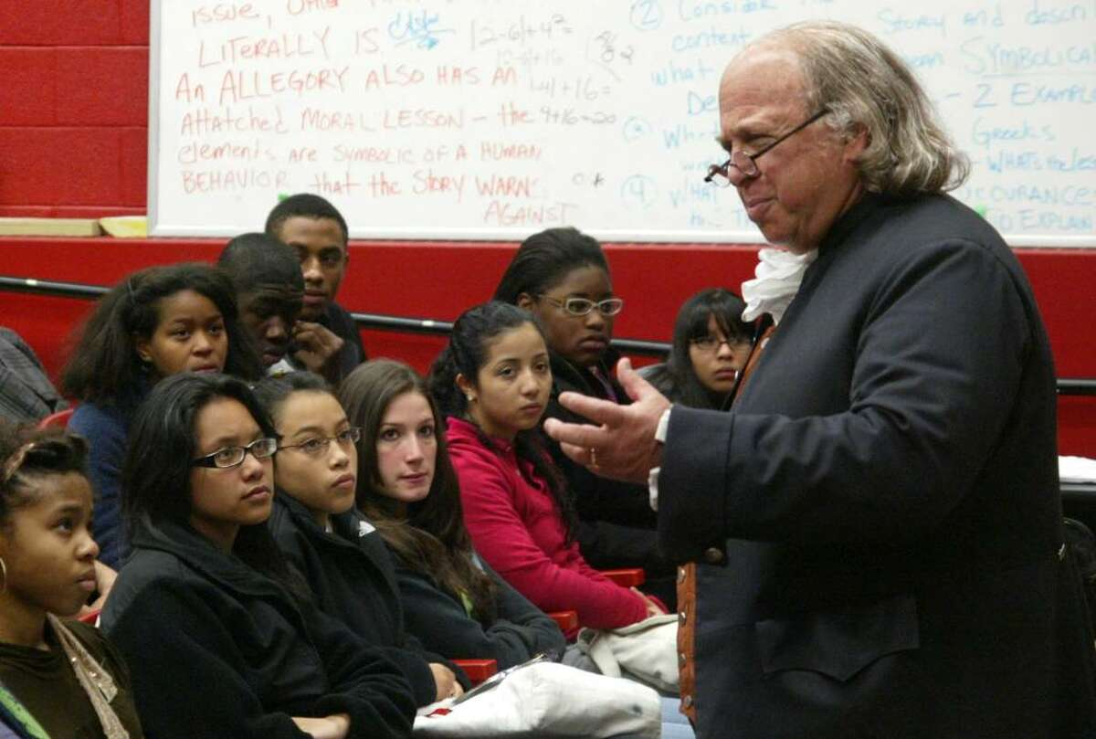 Christopher Lowell, dressed as Benjamin Franklin gives Central High School students a presentation on Franklin's historical contributions during a small assembly at the Bridgeport school, Tuesday, Oct. 20, 2009.