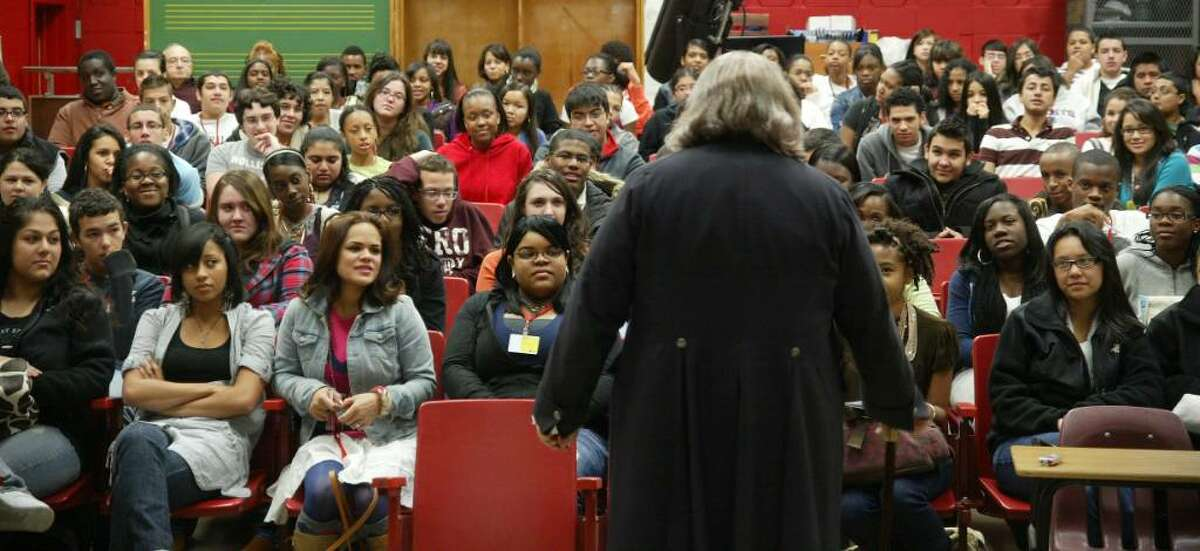 Christopher Lowell, dressed as Benjamin Franklin gives Central High School students a presentation on Franklin's historical contributions, during a small assembly at the Bridgeport school, Tuesday, Oct. 20, 2009.