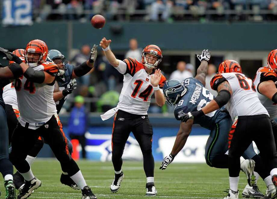 SEATTLE - OCTOBER 30:  Quarterback Andy Dalton #14 of the Cincinnati Bengals throws a pass against the Seattle Seahawks on October 30, 2011 at Century Link Field in Seattle, Washington. Photo: Jonathan Ferrey, Getty Images / 2011 Getty Images