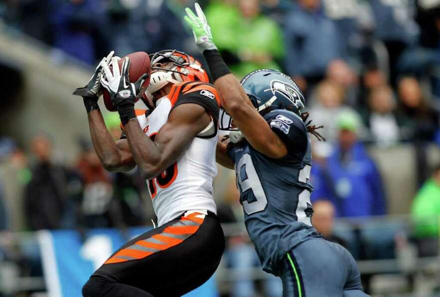 SEATTLE - OCTOBER 30:  A. J. Green #18 of the Cincinnati Bengals cathes a touchdown pass in the seco