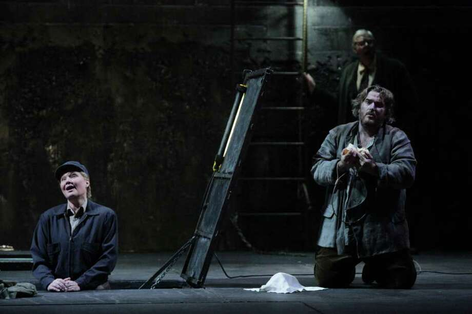 FELIX SANCHEZ: HOUSTON GRAND OPERA THE GREAT ESCAPE: Karita Mattila (Leonore), from left, Simon O'Neill (Florestan) and Kristinn Sigmundsson (Rocco) star in Houston Grand Opera's production of Fidelio. Photo: Felix Sanchez