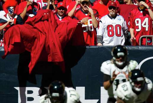 Houston Texans fans wearing Halloween costumes taunt Jacksonville Jaguars quarterback Blaine Gabbert (11) during the third quarter at Reliant Stadium on Sunday, Oct. 30, 2011, in Houston. Photo: Smiley N. Pool, Houston Chronicle / © 2011  Houston Chronicle