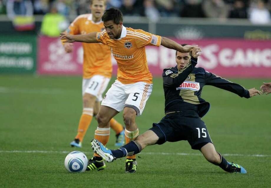 CHESTER, PA - OCTOBER 30: Gabriel Farfan #15 of the Philadelphia Union tackles Danny Cruz #5 of the Houston Dyanmo during an MLS soccer playoff game, October 30, 2011 at PPL Stadium in Chester, Pennsylvania. Photo: Chris Gardner, Getty / 2011 Getty Images