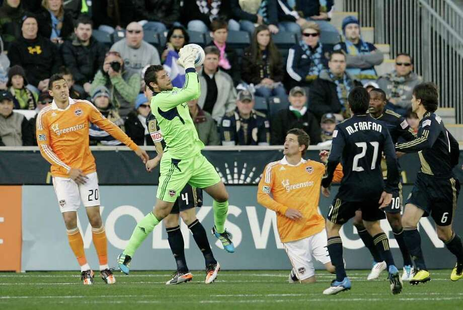 CHESTER, PA - OCTOBER 30:  Goalie Tally Hall #1 of the Houston Dyanmo makes a save in a crowd during an MLS soccer playoff game against the Philadelphia Union, October 30, 2011 at PPL Stadium in Chester, Pennsylvania. Photo: Chris Gardner, Getty / 2011 Getty Images
