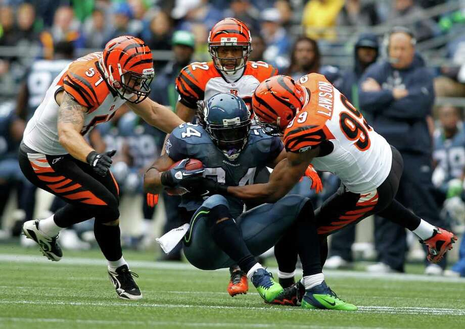 SEATTLE - OCTOBER 30:  Marshawn Lynch #24 of the Seattle Seahawks is tackled by the defense of the Cincinnati Bengals on October 30, 2011 at Century Link Field in Seattle, Washington. Photo: Jonathan Ferrey, Getty Images / 2011 Getty Images