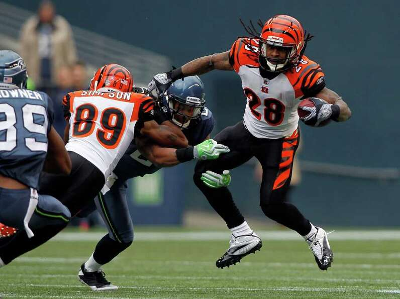 SEATTLE - OCTOBER 30:  Bernard Scott #28 of the Cincinnati Bengals runs the ball against the Seattle