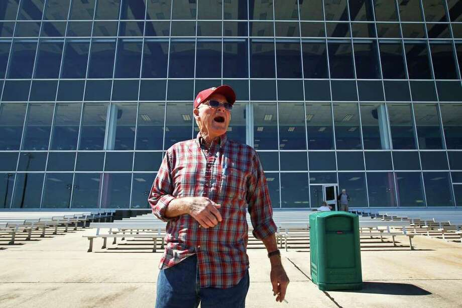 Ronald Buck cheers on the dogs he placed a bet on during the Wednesday Matinee at Gulf Greyhound Park on  Oct. 19, 2011, in La Marque, Texas.  Gulf Greyhound Park, a $55 million-plus facility sprawling over 110 acres, opened amid fanfare in 1992 as the grandest dog track in Texas. Now, hard times have left it the state's only dog track regularly scheduling live events.   (AP Photo/Houston Chronicle, Michael Paulsen)  MANDATORY CREDIT Photo: AP