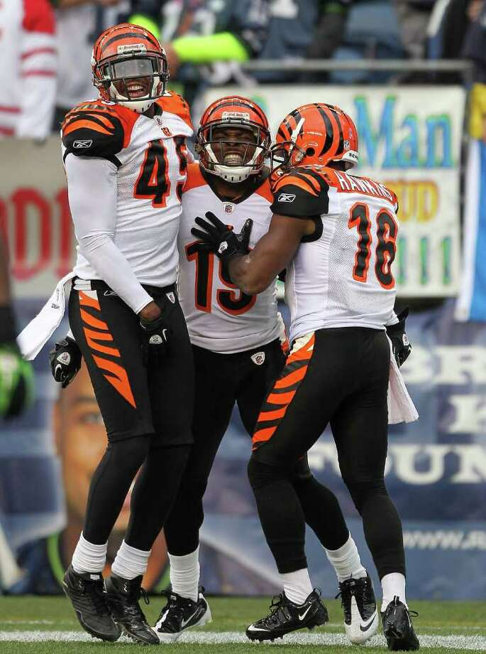 SEATTLE - OCTOBER 30:  Brandon Tate #19 of the Cincinnati Bengals celebrates with Jeromy Miles #45 and Andrew Hawkins #16 after returning a punt for a touchdown against the Seattle Seahawks at CenturyLink Field on October 30, 2011 in Seattle, Washington. The Bengals defeated the Seahawks 34-12. Photo: Otto Greule Jr, Getty Images / 2011 Getty Images