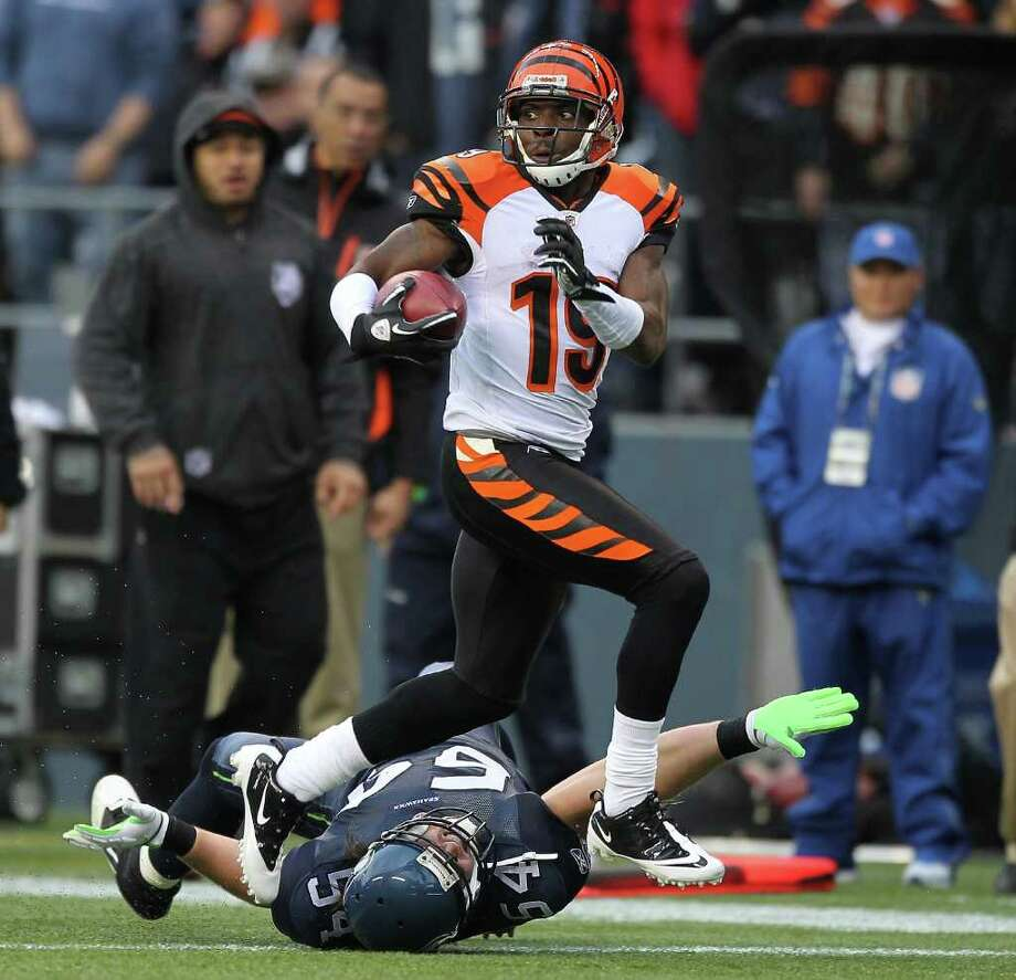 SEATTLE - OCTOBER 30:  Brandon Tate #19 of the Cincinnati Bengals returns a punt for a touchdown against David Vobora #54 of the Seattle Seahawks at CenturyLink Field on October 30, 2011 in Seattle, Washington. The Bengals defeated the Seahawks 34-12. Photo: Otto Greule Jr, Getty Images / 2011 Getty Images