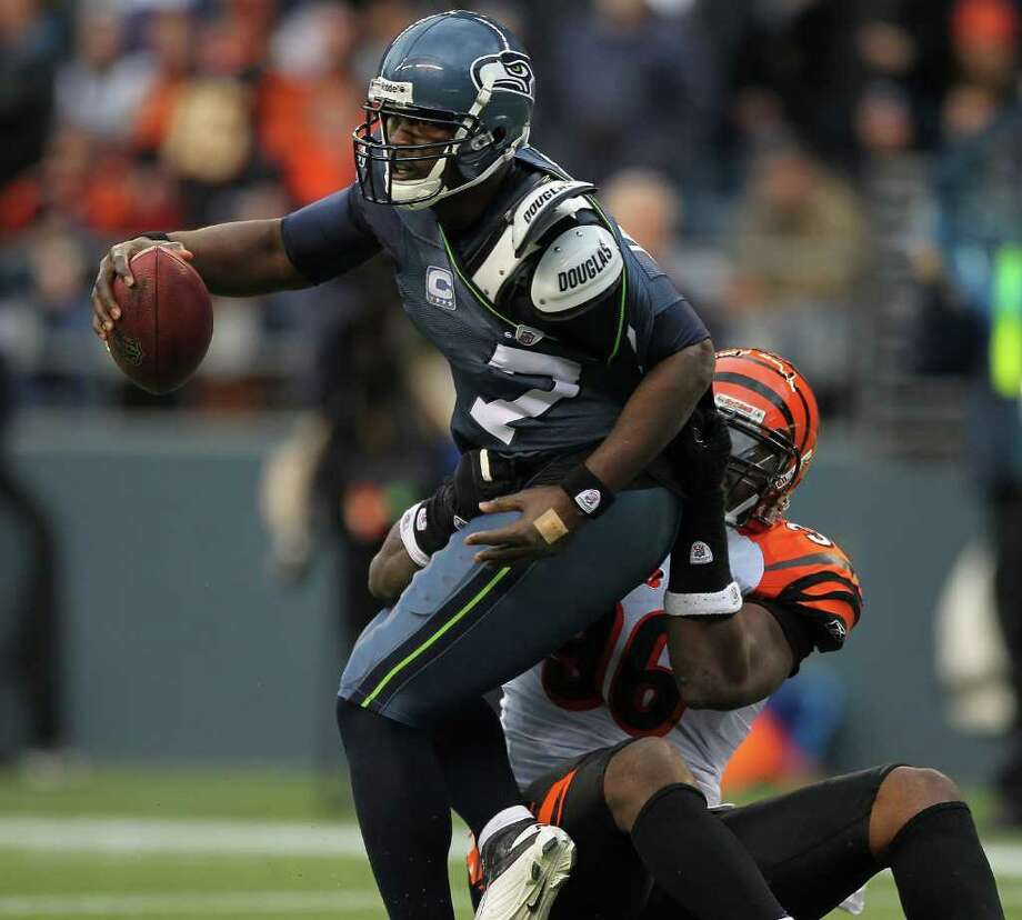 SEATTLE - OCTOBER 30:  Quarterback Tarvaris Jackson #7 of the Seattle Seahawks is sacked by Carlos Dunlap #96 of the Cincinnati Bengals at CenturyLink Field on October 30, 2011 in Seattle, Washington. The Bengals defeated the Seahawks 34-12. Photo: Otto Greule Jr, Getty Images / 2011 Getty Images