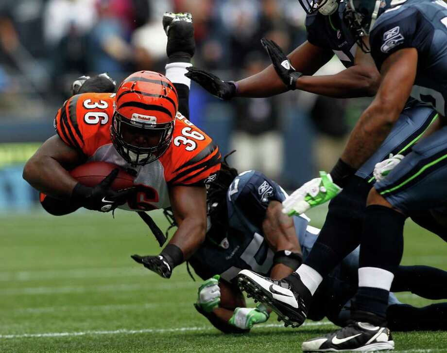 SEATTLE - OCTOBER 30:  Chris Pressley #36 of the Cincinnati Bengals runs the ball against the Seattle Seahawks on October 30, 2011 at Century Link Field in Seattle, Washington. Photo: Jonathan Ferrey, Getty Images / 2011 Getty Images