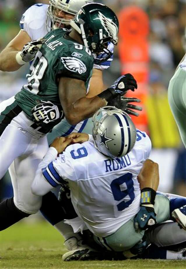 Dallas Cowboys quarterback Tony Romo (9) is hit by Philadelphia Eagles defensive end Trent Cole (58) in the first half of an NFL football game Sunday, Oct. 30, 2011 in Philadelphia. (AP Photo/Michael Perez) Photo: Michael Perez, Associated Press / FR168006 AP