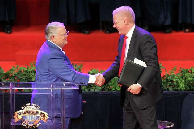 Pastor John Hagee greets Glenn Beck after introducing him at the 30th Annual Night to Honor Israel at Cornerstone Church, Sunday, October 30, 2011. (Jennifer Whitney/ Special to the San Antonio Express-News) Photo: Jennifer Whitney, Special To The Express-News / special to the Express-News