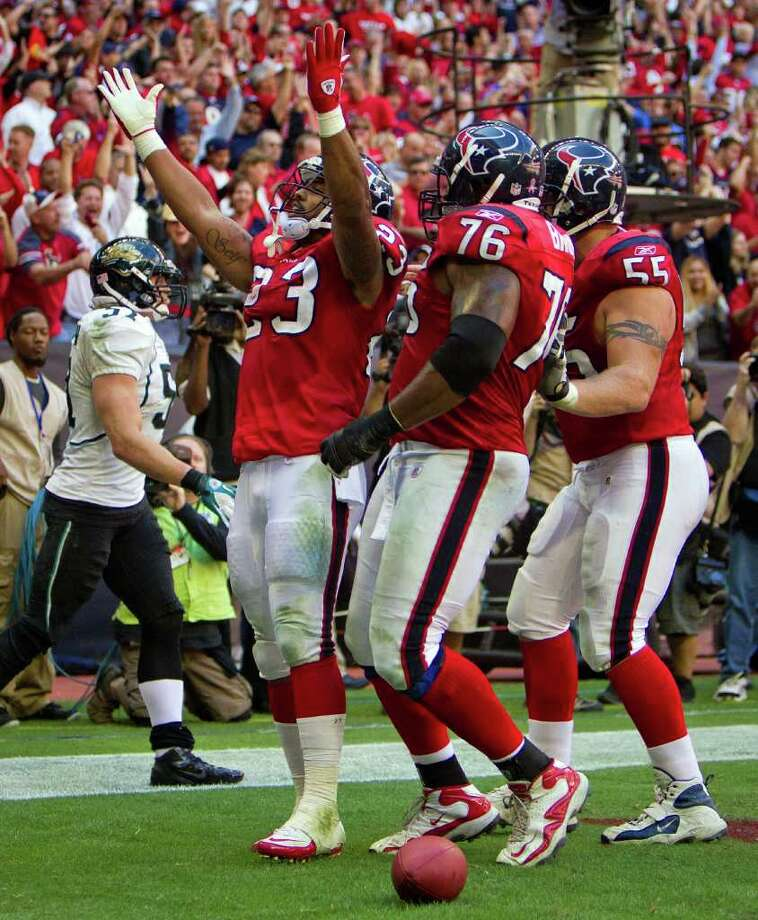 Houston Texans running back Arian Foster (23) celebrates after a 4-yard touchdown run against the Jacksonville. Photo: Smiley N. Pool, Houston Chronicle / © 2011  Houston Chronicle