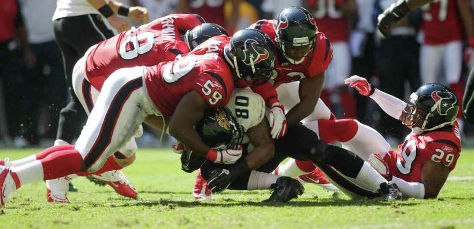 Houston Texans inside linebacker DeMeco Ryans (59), safety Troy Nolan (33) and safety Glover Quin (2