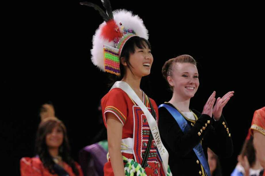 Sarah Yang, 16, left, representing Taiwan, smiles as she is named Miss Festival of Nations during the 40th Annual Festival of Nations at the Empire State Plaza Convention Center on Sunday Oct. 30, 2011 in Albany, NY. She attends Shenendehowa High School.  (Philip Kamrass / Times Union ) Photo: Philip Kamrass / 00015120A