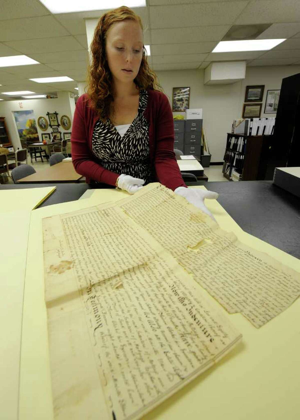 Historian Lauren Roberts, Saratoga County Historian looks over some of the documents October 20, 2011 at the Saratoga County office building in Ballston Spa, N.Y. that were found under a floorboard of a home in Charlton. (Skip Dickstein / Times Union)
